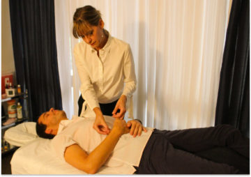Lesley treating a patient